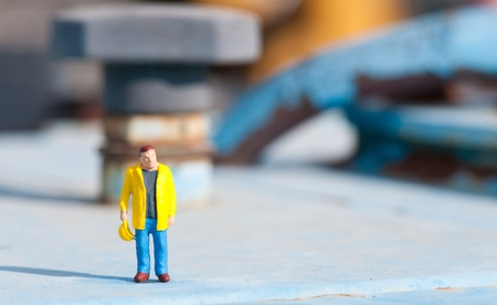 blue collar: Figurine of construction worker at construction site
