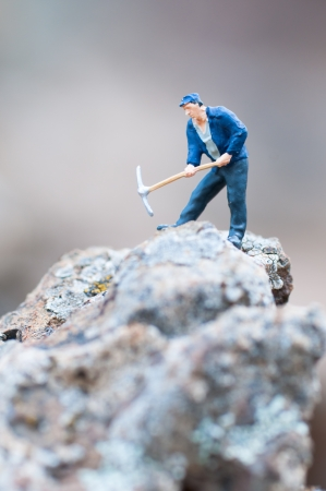 Miner with pickaxe photo