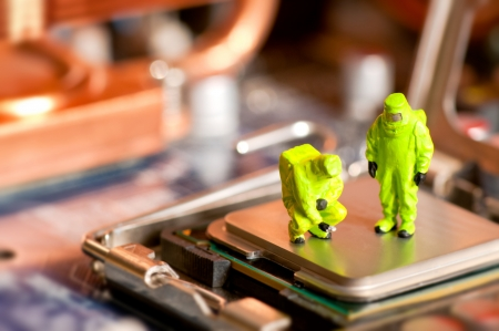 Group of people in protective suit inspecting computer processor photo