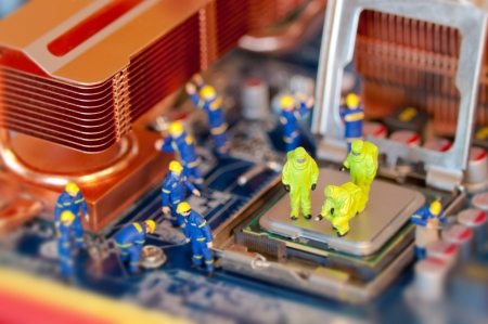 mainboard: Group of Technicians repairing computer Stock Photo