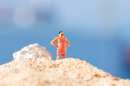 swimming costume: Man in vintage swimming costume standing on the beach Stock Photo