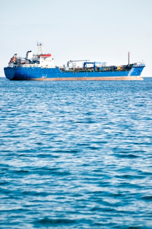 Trading ship in the open sea photo