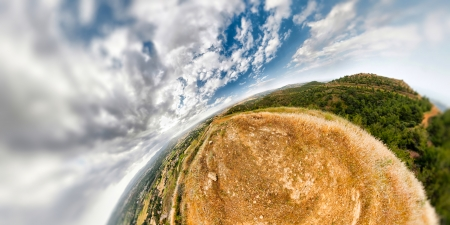 equirectangular: An earhtly rocky mountain landscape with an extreme wide angle wrapping