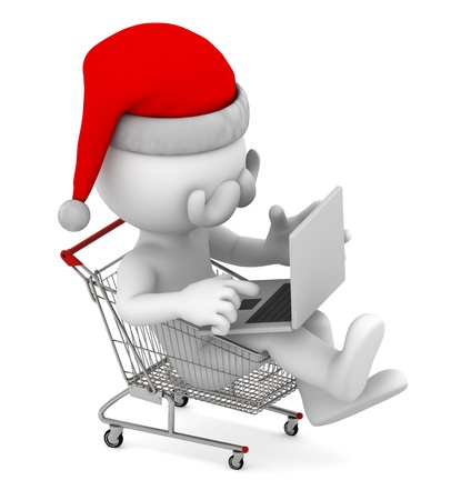 Santa with laptop inside shopping cart. E-commerce concept. Isolated photo