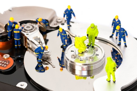 miniature people: Group of engineers maintaining hard drive  Computer repair concept