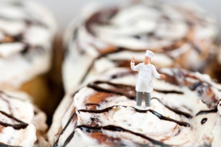 Miniature Chef on top of the Cinnamon roll Stock Photo - 18430006