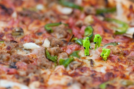 Scientists inspecting giant pizza. Unhealthy food concept. Macro photography Stock Photo - 22650873