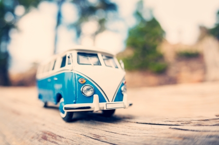 camper trailer: Miniature old fashioned vintage van on a countryside road. Macro photo