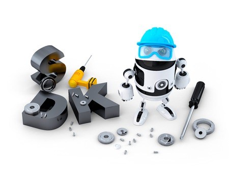 Robot with tools and SDK sign. Technology concept. Isolated over white background photo