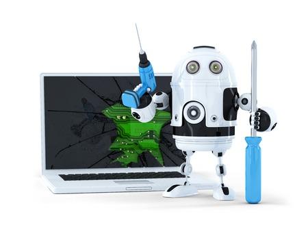 Robot con herramientas y un ordenador port�til roto. Aislado
