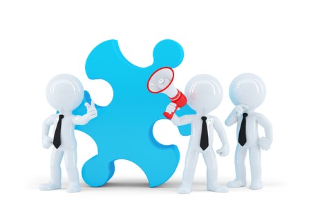 Team of business people and piece of a puzzle. Business concept. Isolated photo