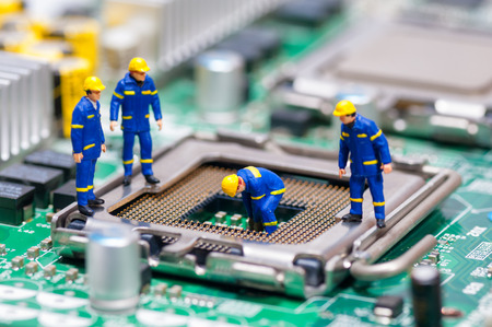 Group of construction workers repairing CPU. Technology concept Stock Photo