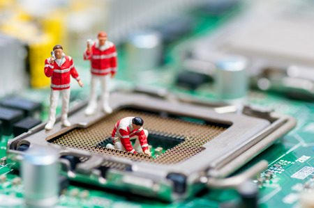computer parts: Group of paramedics recovering damaged CPU. Technology concept Stock Photo