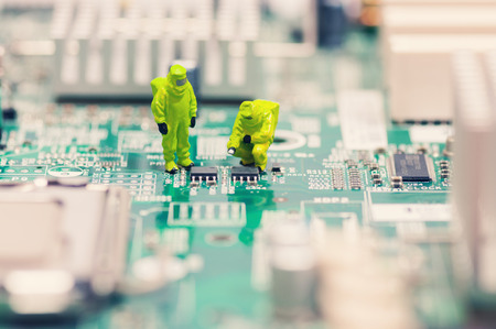 Technicians repairing circuit board Stock Photo