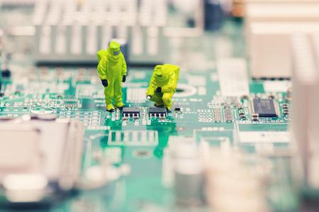 Technicians repairing circuit board Standard-Bild