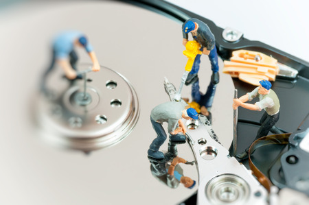 hdd: Workers repairing hard drive.