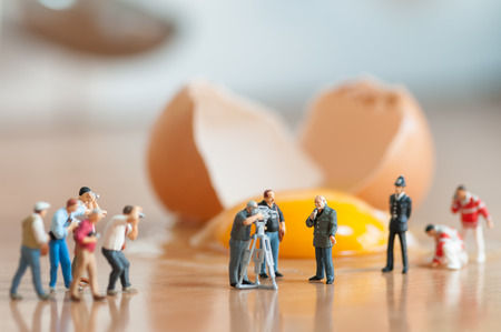 miniature people: Broken egg  Accident in the kitchen  Macro photo
