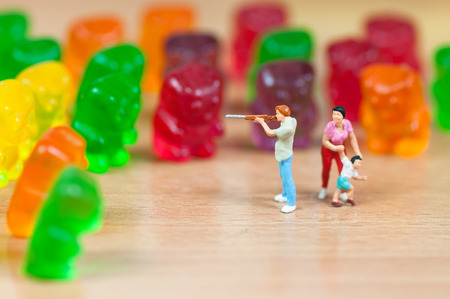 Gummy bear invasion. Junk food concept Stock Photo