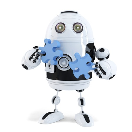 Robot connecting puzzle pieces. Technology concept. Isolated. Contains clipping path photo