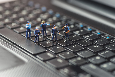 the police: Computer Crime Concept. Macro photo