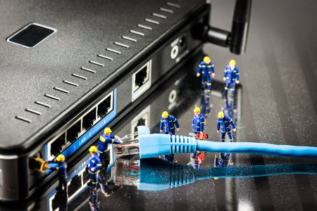 Miniature Network Engineers At Work. Technology concept.Macro photo