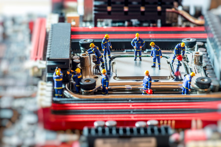 Group of Technicians repairing CPU. Technology concept. Macro photo