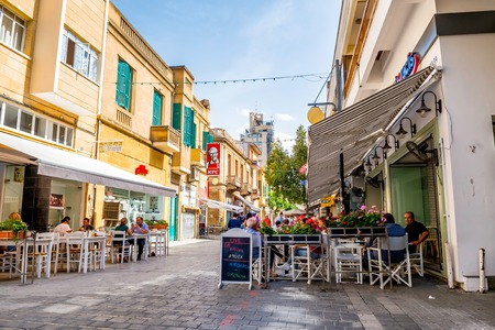 cafe: NICOSIA, CYPRUS - MAY 29:  People enjoying a summer in cafes at Onasagorou street in central Nicosia, Cyprus.