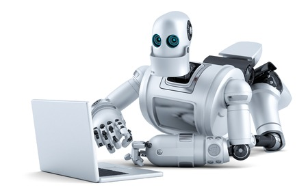 man using computer: Robot laying on floor with laptop.  Stock Photo