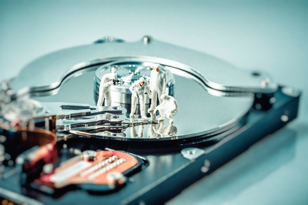 Group of criminalists inspecting hard drive. Technology concept. Macro photo.