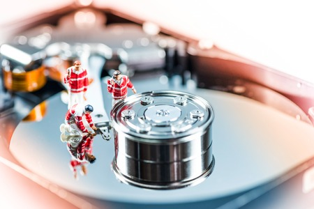 data recovery: Rescue Team recovering damaged HDD. Macro photo