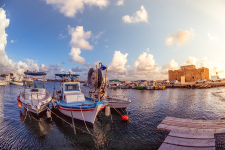 Boats at Paphos harbor with the castle on the background. Cyprus. Stock Photo - 43218284
