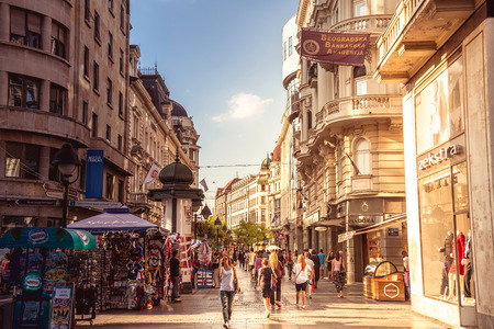 balkan: BELGRADE, SERBIA - SEPTEMBER 23: Knez Mihailova Street on September 23, 2015 in Belgrade, Serbia. Street is the main shopping mile of Belgrade. Filtered photo with warm summer lighting. Editorial