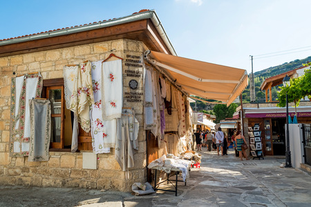 souvenir: OMODOS, CYPRUS - OCTOBER 4, 2015: Traditional souvenir shops with embroidery lace, on OCTOBER 4 in Omodos village. Editorial