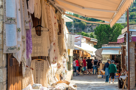souvenir traditional: OMODOS, CYPRUS - OCTOBER 4, 2015: Traditional souvenir shops with embroidery lace, on OCTOBER 4 in Omodos village. Editorial