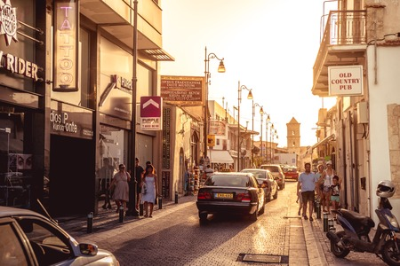 lazarus: LARNACA, CYPRUS - SEPTEMBER 10, 2015: Pavlou Valsamaki street, a touristic street leading to The Church of Saint Lazarus, on September 10 in Larnaca. Color tone tuned photo