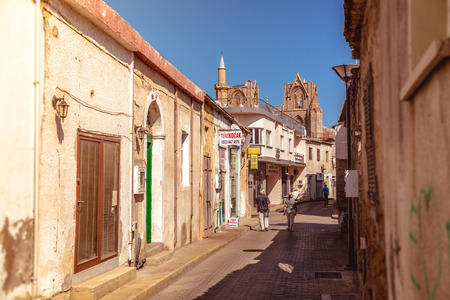 st  nicholas cathedral: FAMAGUSTA, CYPRUS - OCTOBER 10: Lala Mustafa Pasa street, a touristic street leading to St. Nicholas Cathedral.  Filtered photo with warm summer lighting.