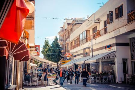 thoroughfare: NICOSIA - APRIL 13 : People walking on Ledra street on April 13, 2015 in Nicosia, Cyprus. It is is a major shopping thoroughfare in central Nicosia