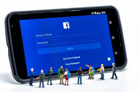 LIMASSOL, CYPRUS - DECEMBER 07, 2015: Group of people watching at Facebook application sign in page on smartphone. Social networking concept
