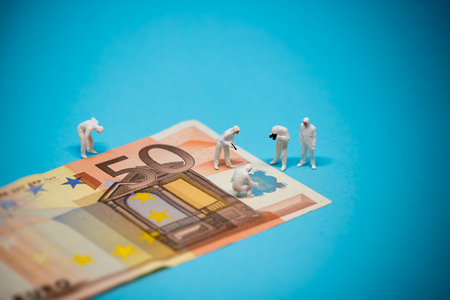 Specialists inspecting 50 euro banknote. Fraud concept. Macro photo Stock Photo