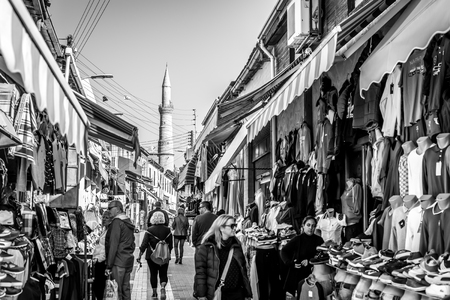 MEDITERRANEAN MARKETPLACE: NICOSIA, CYPRUS - DECEMBER 3: People shopping at open-air market on Arasta street, a touristic street leading to Selimiye mosque in central Nicosia on December 3, 2015. Editorial