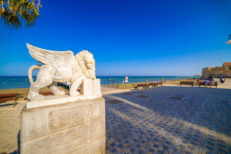 leon alado: LARNACA, CYPRUS - AUGUST 16: Winged Lion statue at Foinikoudes promenade on August 16, 2015 in Larnaca, Cyprus.