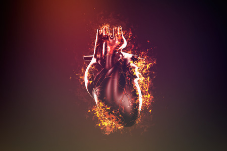 Abstract human heart in flame and smoke Stock Photo