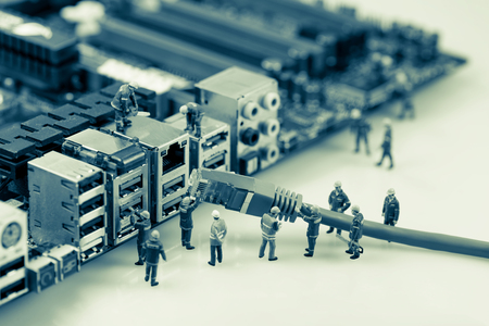 desktop computer: Technicians connecting network cable to motherboard. Network connection concept Stock Photo