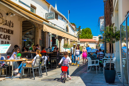 sidewalk: LIMASSOL, CYPRUS - April 01, 2016: Tourists and locals enjoying a summer in cafes at Castle Square.