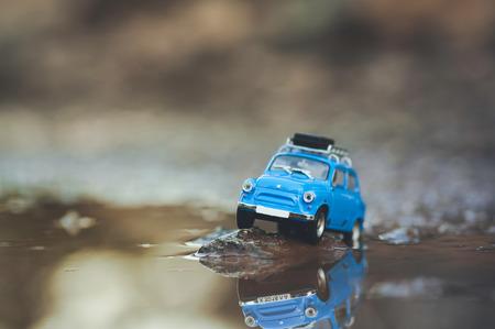 Small cute retro travelling car. Macro photo. Stock Photo
