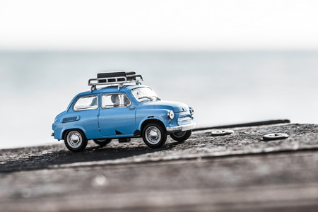 Cute blue retro travel car with luggage. Macro photo.