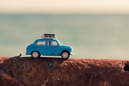 summer beach: Vintage car parked near the sea. Travel and adventure concept.