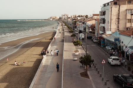 castle district: LARNACA, CYPRUS - JUNE 3, 2016: Piale Pasa street and seafront. View from the Fort of Larnaca. Cyprus.