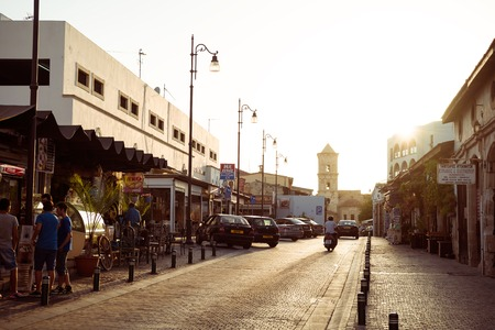 lazarus: LARNACA, CYPRUS - AUGUST 16, 2015: Sundown at old street leads to the Lazarus Church in the center of the old town of Larnaca.