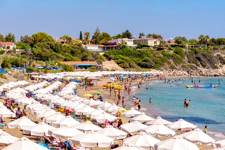 PAPHOS, CYPRUS - JULY 24, 2016: Coral Bay Beach, one of the best sandy beaches located near Pegeia village